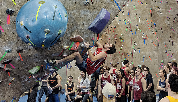 Junior Keegan Nichols placed 15th out of 58 competitors in men's bouldering at Saturday's Northeast Region competition. (Photo by Elliot Gaunt) test test test test