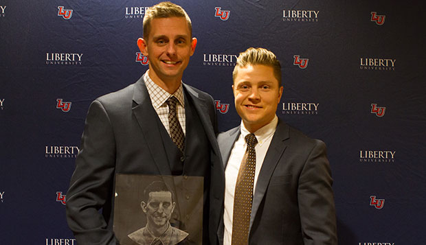 Jeremy Kortright (left) poses with Liberty men's lacrosse Head Coach Kyle McQuillan after the Nov. 13 Club Sports Hall of Fame induction ceremony in the Hancock Welcome Center.  test test test test