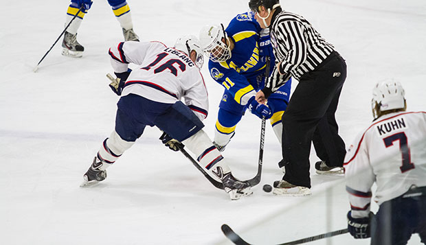 Liberty junior forward Lindsay LeBlanc takes a faceoff in front of senior defenseman Jackson Kuhn in a 6-1 win over the Blue Hens on Nov. 8 at the LaHaye Ice Center. test test test test