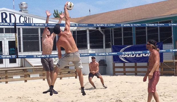 Flames graduate students Ethan Chase (left) and Kaleb VanDePerre put up a block and provide back-row defense in Saturday's Wilmington (N.C.) Volleyball Series July Sizzler. test test test test