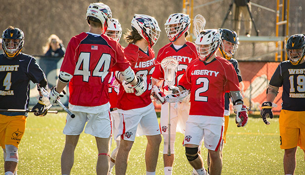 Flames players celebrate a goal in Saturday's 18-5 victory over SELC Northwest rival West Virginia. (Photo by Joel Isimeme) test test test test