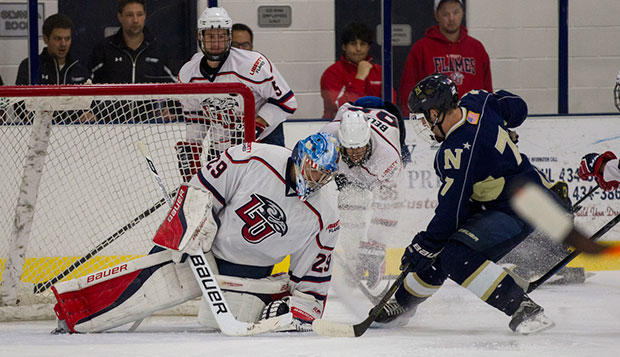 Flames sophomore goalie Matt Pinel stuffs a shot by Navy forward Dan O'Hear late in Friday night's 5-4 shootout loss, the ACHA opener for both teams at the LaHaye Ice Center. test test test test