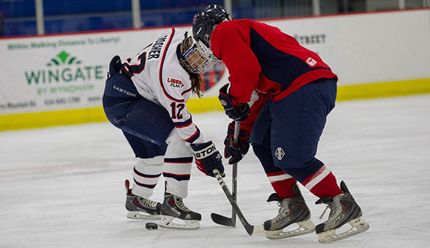 Liberty junior defenseman Madi Fischer (left) scored the Lady Flames' only goal with just over a minute remaining in the second period, Thursday morning against Massachusetts. test test test test