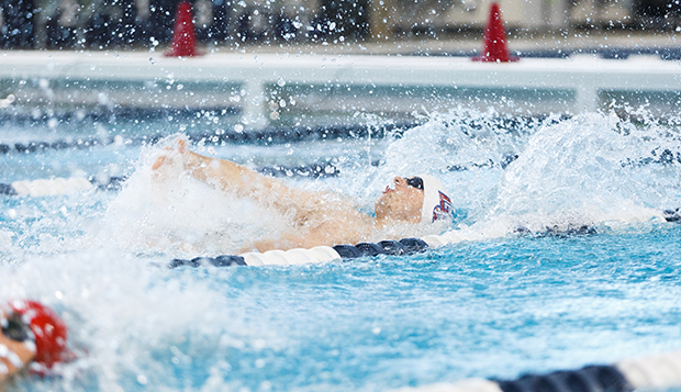 Flames freshman Matt Davidson competes in the backstroke at the Liberty Natatorium on Sept. 27. (Photos by Luke Bobbey) test test test test