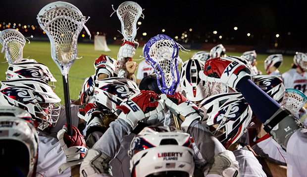 The Flames celebrate a March 10 upset of then-No. 10 Arizona State at the Liberty Lacrosse Fields. (Photo by Andrew Snyder) test test test test