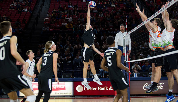 Flames outside hitter Sam Hess goes up for a spike attempt beside teammates (from left) Daniel Koloff, Sam Wyman, Kaleb Knepper, and Gene Dejesus. (Photo by Andrew Snyder)   test test test test