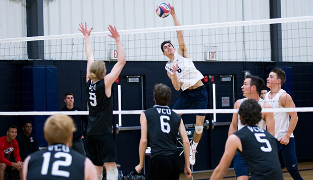 Height, depth factors in favor of Flames' volleyball teams test test test test