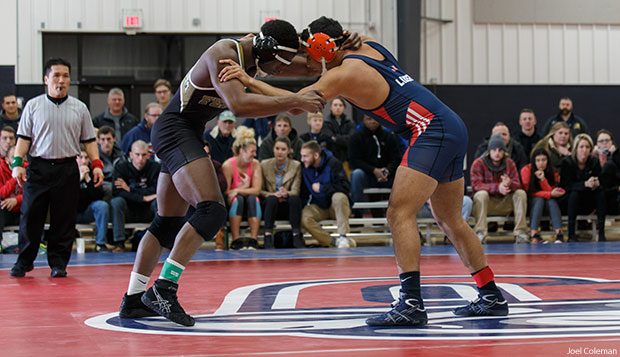 Liberty 165-pounder Michael Bryant (right) wrestles in a Feb. 10 dual match against Ferrum in the LaHaye Multipurpose Center. test test test test