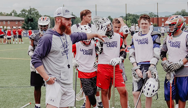 Flames Assistant Coach Mike Zumpano directs campers at the Liberty Lacrosse Fields. (Photos courtesy of Sam Pyo) test test test test