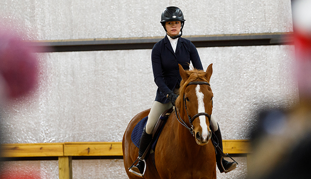 Nadia Cooper, who rides in Intermediate Fences, was one of three sophomores to qualify for the Zone 4 competition before it was canceled by COVID-19. (Photo by Luke Bobbey) test test test test