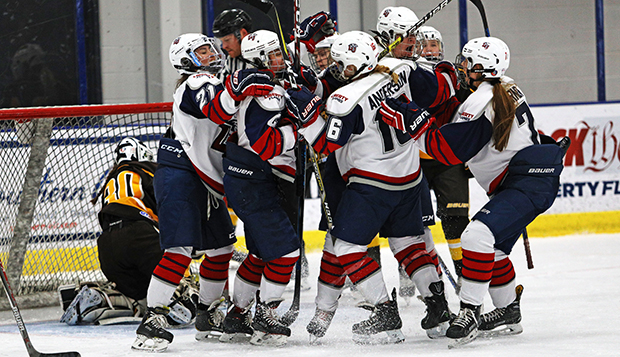 Liberty's ACHA DII women's hockey players celebrate a goal against Rowan on Jan. 18. (Photo by Jenna McKenney) test test test test