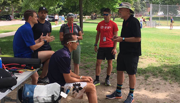 Parker Spencer (in red) listens to Bobby McGee, an Olympic running coach, along with the other participants in last month's Elite Coach Development Program. test test test test