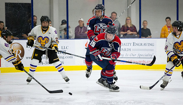 Ryan Cox and Zechariah Roberts battle for puck possession during Liberty's Midnight Mayhem win over West Chester on Sept. 23 at the LaHaye Ice Center. (Photo by Leah Seavers) test test test test