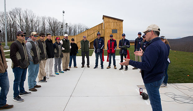 Shooting sports Head Coach Dave Hartman (right) addresses his team members at the shotgun range at the Liberty Mountain Gun Club last spring. (Photo by Kevin Manguiob) test test test test