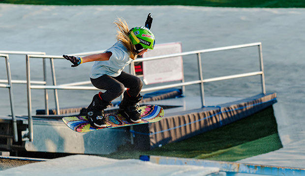 Danielle Dennis from North Carolina grabs some air in the girls snowboard Rail Jam during last Tuesday night's Virginia Commonwealth Games at Snowflex. (Photos by Ross Kohl) test test test test