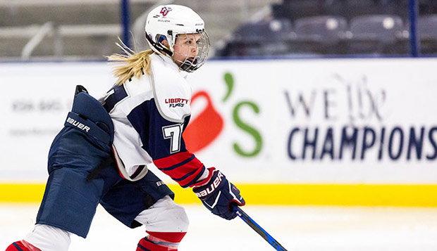 Liberty ACHA Division I women's hockey defenseman Sydney Pierce and her teammates have allowed only 22 goals this season and take a 25-3 record and No. 1 ranking into nationals. (Photo by Joel Isimeme) test test test test