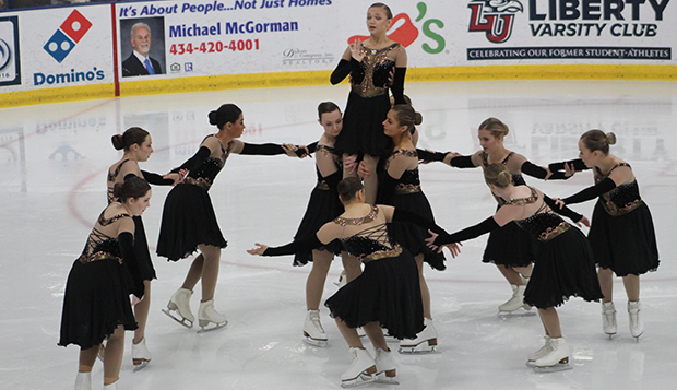 The Lady Flames perform during intermission of the DI men's hockey team's game, Oct. 19 at the LaHaye Ice Center. test test test test