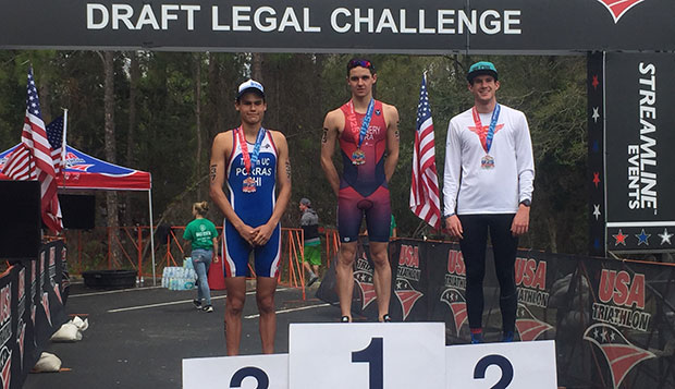 Liberty freshman Thomas Sonnery-Cottet (center) stands atop the podium after winning Sunday's second U25 Elite Development Race in 58 minutes, 15 seconds. test test test test