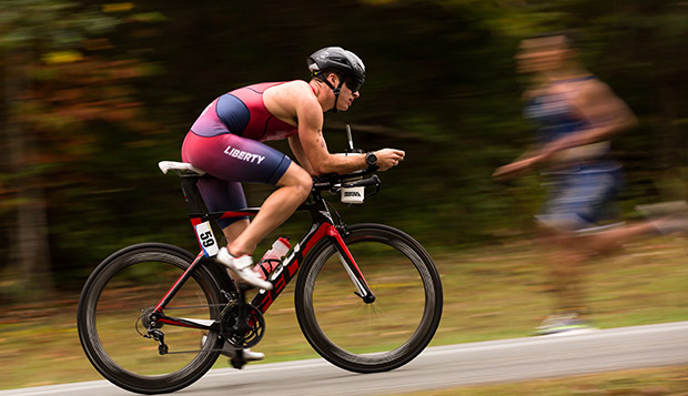 A Liberty cyclist passes an approaching runner in last year's Mid-Atlantic Collegiate Regional Championships at Smith Mountain Lake. (Photo by Kevin Manguiob) test test test test