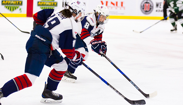 Lady Flames junior Vanessa DeMerchant (8) and sophomore linemate Shannon Fehr combined for three goals Saturday. (Photo by Jessie Rogers) test test test test