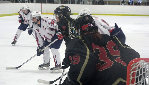 Liberty senior forward Stacey McCombe (92), who scored the game's first goal, awaits the start of the Lady Flames' 5-on-3 power play in the closing seconds of the first overtime in a 2-1 ACHA DI national semifinal triumph over Robert Morris. test test test test