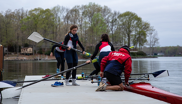 Members of Liberty's new women's Varsity 4 will compete in this weekend's season-opening regatta. (Photos by KJ Jugar) test test test test