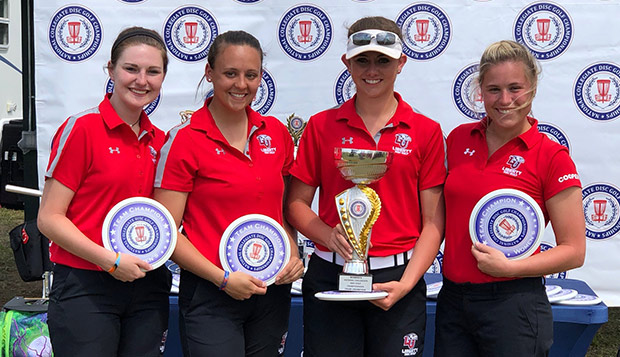 Lady Flames Championship flight players Savanna Fox (left), Hannah Trotz, Heather Wyatt, and Cortney Cooper hold their team trophy. test test test test