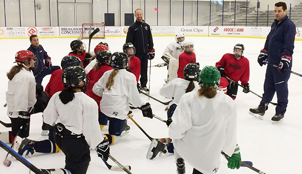Liberty ACHA Division I women's hockey Head Coach Chris Lowes (right) and DI men's Head Coach Ben Hughes (center) help direct the 22 middle- and high school-aged girls campers in a session on Wednesday afternoon at the LaHaye Ice Center. test test test test