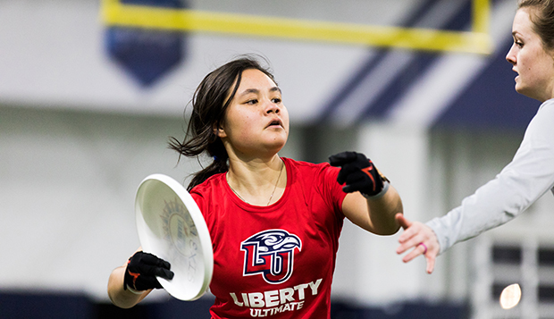 Lady Flames junior handler Brianna Kuo looks downfield in the Liberty Indoor Practice Facility. (Photo by Gabrielle Calhoun) test test test test