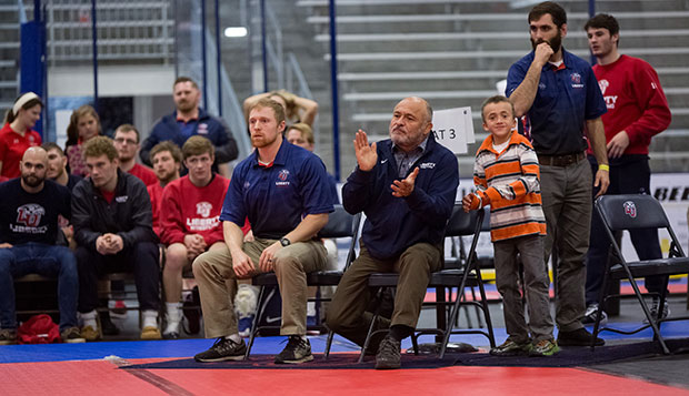 Flames Head Coach Jesse Castro encourages a wrestler during last January's NCWA National Duals in the LaHaye Ice Center.  test test test test