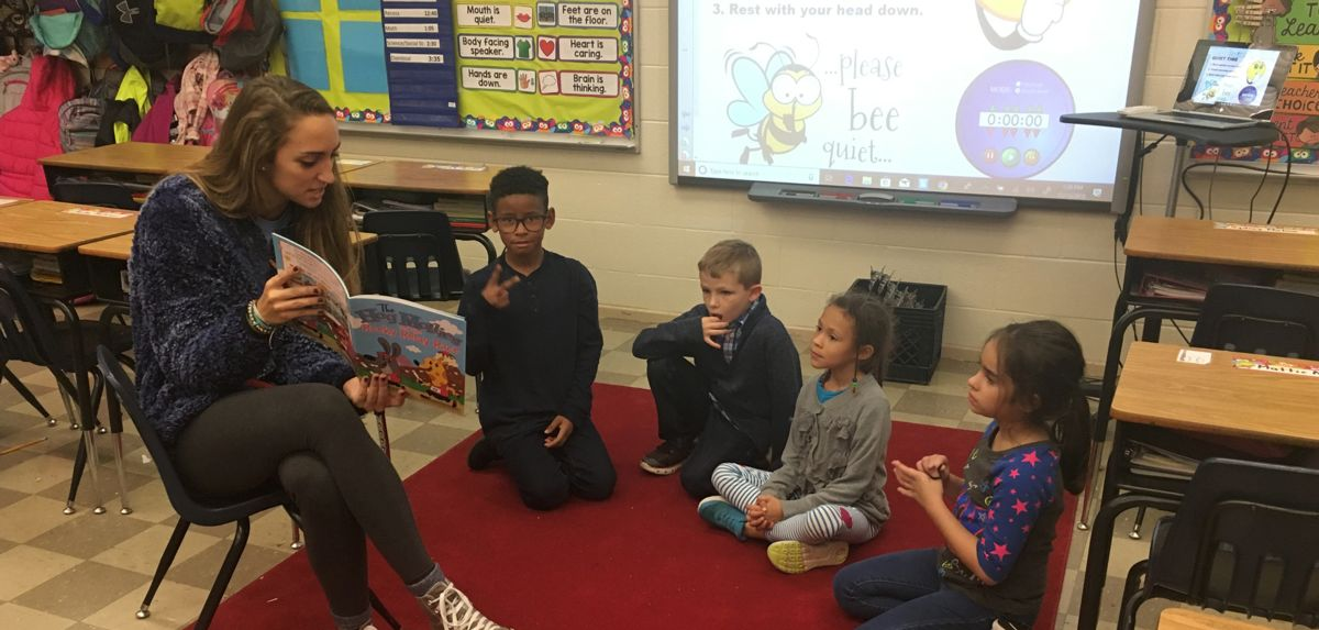 Liberty student-athletes partook in the Flames READ initiative at Sandusky Elementary School.