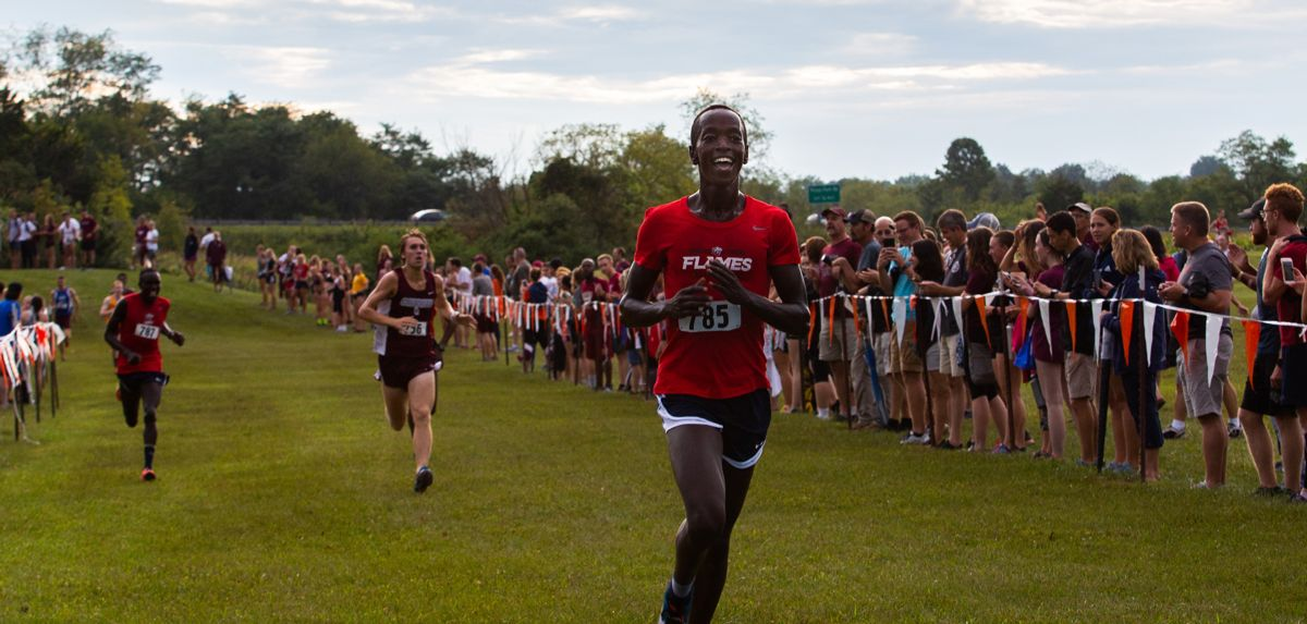Azaria Kirwa celebrates his victory at the Virginia Tech Invitational.