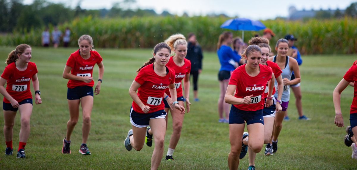 Naomi Bowser (front right) served as the Lady Flames' No. 1 runner during Friday's Royals Challenge.