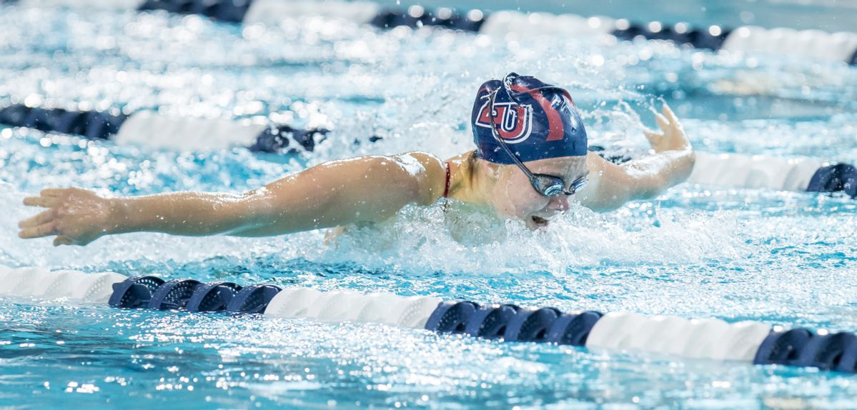 Alicia Finnigan won the 100 fly on Saturday at the Liberty Invitational