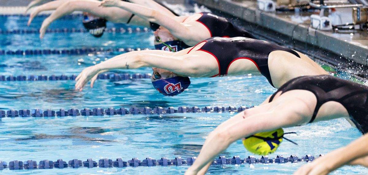 Payton Keiner won the 100 backstroke and led off two winning relays on Saturday at FGCU.
