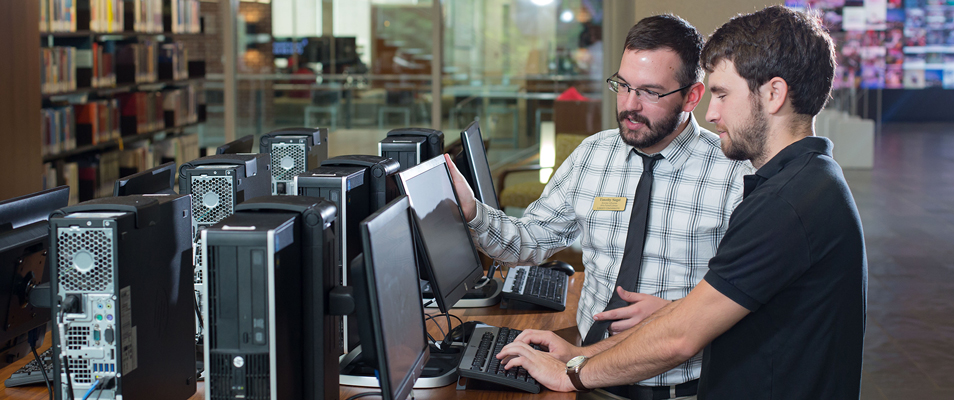Student getting assistance on computer