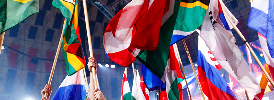 Flags waving in air in Vines Center during Parade of Nations