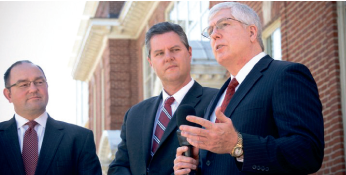 Photo Provided MAKING A STATEMENT — Law School Dean Mat Staver (right), Chancellor Jerry Falwell Jr. and City Councilman Jeff Helgeson hold a press conference, talking about the lawsuit that Liberty University filed against the government Friday.
