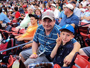 "Rich took his son Ryan at Fenway Park for the Cape Cod Baseball League All-Star Game. "" It was his first trip to Fenway and he had a blast. I got him a press pass to do interviews and take photos with me during the pre-game stuff,"" Rich said. Photo provided"