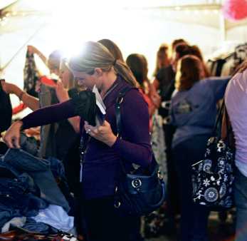 Purchasing for freedom's sake — Shoppers bought over 2,500 sweaters, jeans, shoes, accessories, dresses and other pieces of donated merchandise at Robin Alexander's Frocks for Freedom event. Photo credit: Jessica Shadel