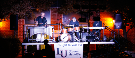 Enjoying the vibes — Students gathered under the night sky to enjoy the sounds of the Bob Peckman Trio. Photo credit: Bekah Lohr