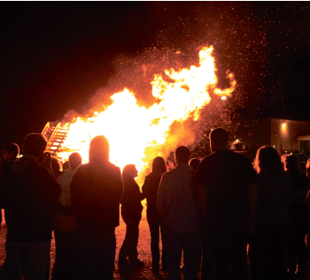 Feel the burn — Students gathered Friday, Oct. 14, for Liberty's annual Homecoming bonfire to rally excitement in preparation for Saturday's football game against Costal Carolina. Photo credit: Ruth Bibby