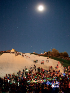 Glow on the snow — Students gathered on the slopes for a late night snowboard performance and party. Photo credit: Ruth Bibby