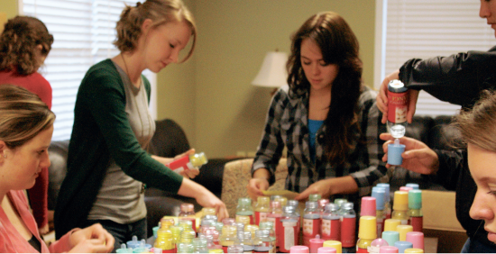 One penny at a time — Godparent Home volunteers prepare baby bottles for the campuswide Baby Bottle Campaign. All money from the fundraiser goes towards helping pregnant young women have resources, education and a safe place to stay during their pregnancy, and provides them an alternative to abortion. Photo credit: Stephanie Marshall