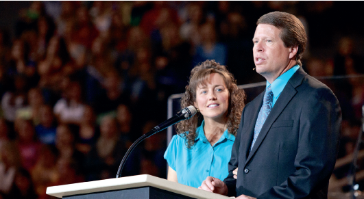Super parents — Reality star parents Jim Bob and Michelle Duggar spoke to a packed Vines Center during convocation, challenging students to follow God no matter what the cost. Photo credit: Ruth Bibby