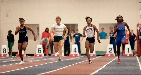 Jump start— Liberty men's and women's track and field dashed past challengers, winning nine events after hosting its open this past weekend. Photo credit: Ruth Bibby