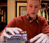 Not your average Joe — Brennan Beikert prepares his own perfect brew, roasting coffee beans himself in a popcorn popper in his dorm. Photo credit: Kate Powley