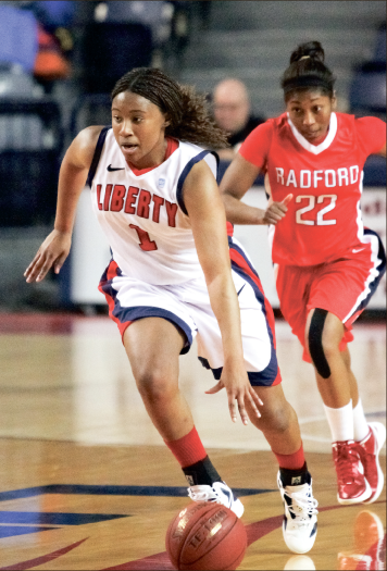 Tournament push — The Lady Flames end the season with a 72-66 victory. LaKendra Washington (1) chipped in with eight points. Photo credit: Ruth Bibby