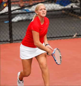 It's all love — Rebekah Jenkins and the Lady Flames have been rolling since the end of spring break, winning the last six of seven matches. Photo credit: Les Schofer, Promotional Publication