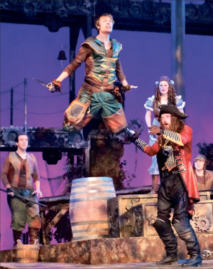 Flying — The musical climaxes as Peter Pan (Caleb Hughes) and Captain Hook (Professor Chris Nelson) battle on a pirate ship. Photo credit: Ruth Bibby